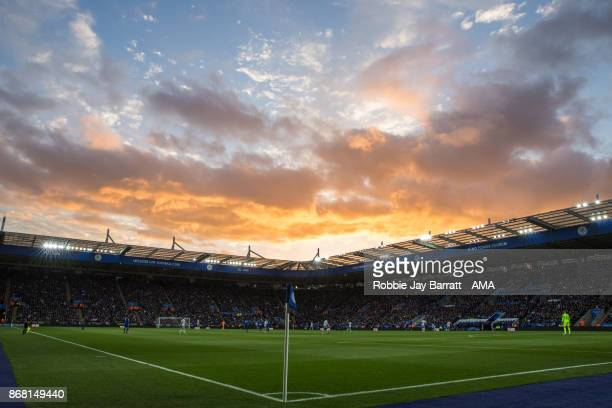 A general view of match action under a sunset at King Power Stadium home stadium of Leicester Cityduring the Premier League match between Leicester...