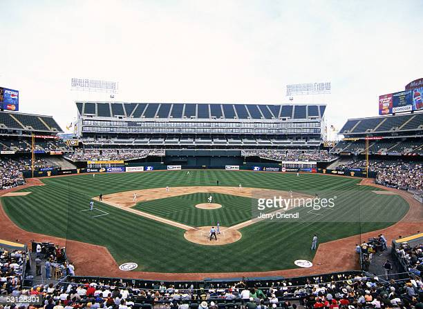 General view of McAfee Coliseum from behind home plate lower level during a game between the Seattle Marines and the Oakland Athletics on April 30...