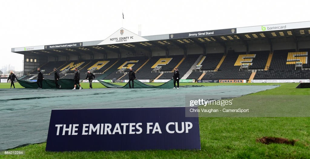 A general view of Meadow Lane, home of Notts County FC as ground staff remove pitch covers prior to the game prior to the Emirates FA Cup Second Round match between Notts County and Oxford City at Meadow Lane on December 2, 2017 in Nottingham, England.