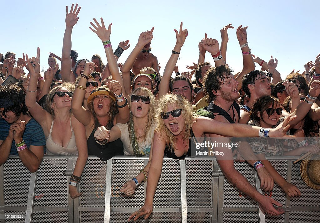 General view of members of the audience cheering in the mosh pit at the front of the crowd at the Pyramid Rock Festival on 31st December 2009 in Phillip Island, Australia.