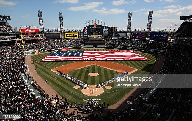 General view of members of the Chicago White Sox and the Kansas City Royals stand during the National Anthem before the Opening Day game at US...
