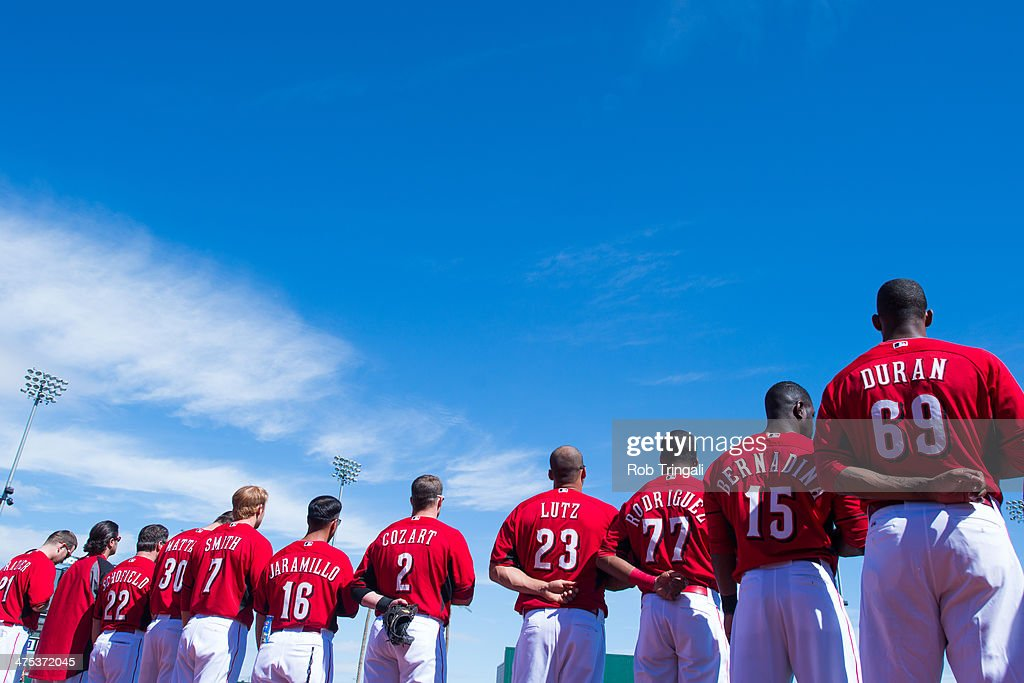 A general view of members of the Cincinnati Reds standing for he Nationla Anthem before the game against the Cleveland Indians at Goodyear Ballpark on February 27, 2014 in Goodyear, Arizona.