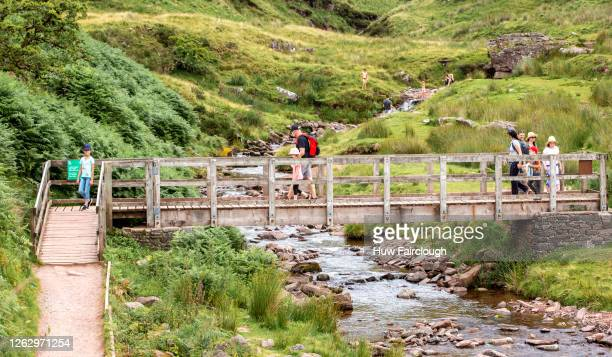 General view of members of the public bathing in the steam and returning after walking Pen y Fan, South Wales highest mountain on July 31, 2020 in...