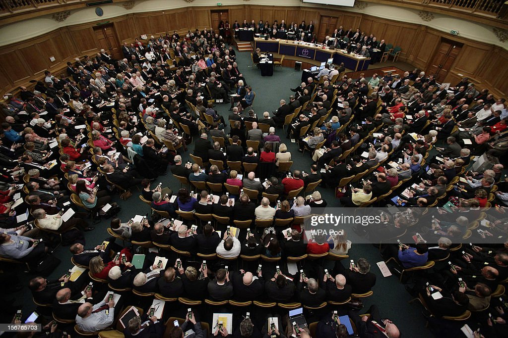 A general view of members voting on handsets to decide whether to give final approval to legislation introducing the first women bishops, during a meeting of the General Synod of the Church of England on November 20, 2012 in London, England. The Church of England's governing body, known as the General Synod, voted on whether to allow women to become bishops.
