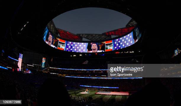 A general view of Mercedes Benz Stadium during the National Anthem with New England Patriots quarterback Tom Brady on the video screen during Super...