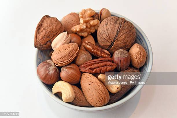 General view of mixed nuts in shell and and unselled including hazelnuts walnuts almonds Brazil nuts pecan nuts pistachio nuts and cashew nuts
