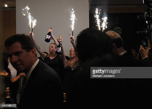 General view of models holding sparkling bottles of Billionaires Row champagne during The Luxury Review Press Preview Private Shopping Experience NYC...