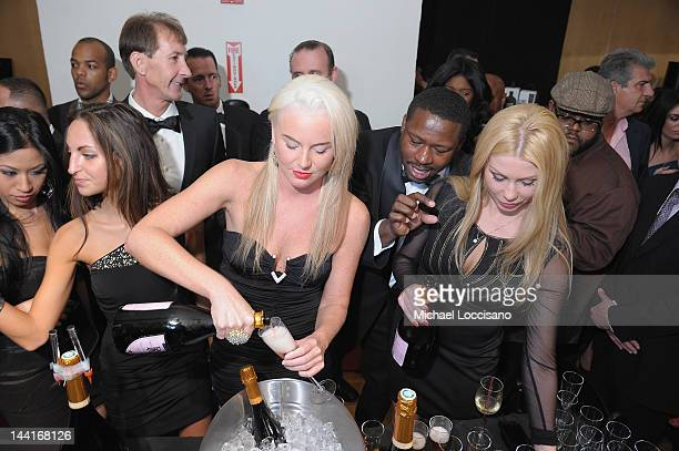 General view of models pouring bottles of Billionaires Row champagne during The Luxury Review Press Preview Private Shopping Experience NYC at...