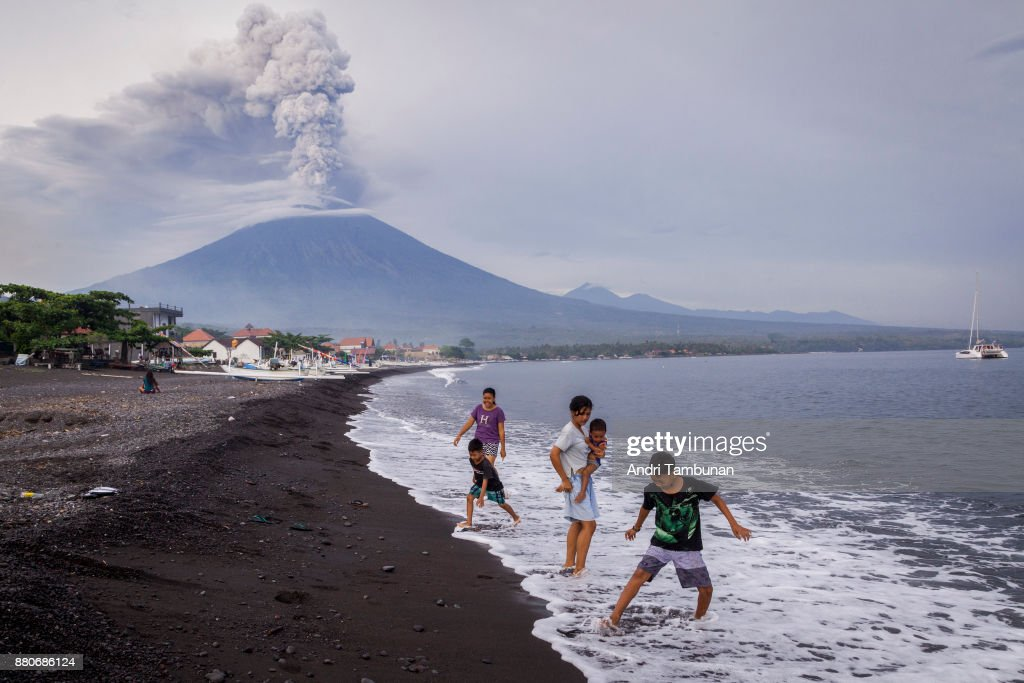 KARANGASEM, BALI, INDONESIA - NOVEMBER 28: General view of Mount Agung during an eruption while spewing volcanic ash into the sky on November on November 28, 2017 in Karangasem, Island of Bali, Indonesia. Indonesian authorities raised the state of alert to its highest level for the volcano, Mount Agung, after thick ash started shooting thousands of meters into the air with increasing intensity. Based on reports, as many as 100,000 villagers will need to leave the expanded danger zone while tens of thousands of tourists have been stranded due to airport closures.