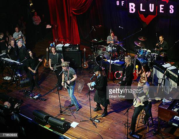 A general view of musicians Jamie Moses Mark Hudson on tambourine drummer Sandy Gennaro and guitarist Jeff 'Skunk' Baxter performing during the Rock...