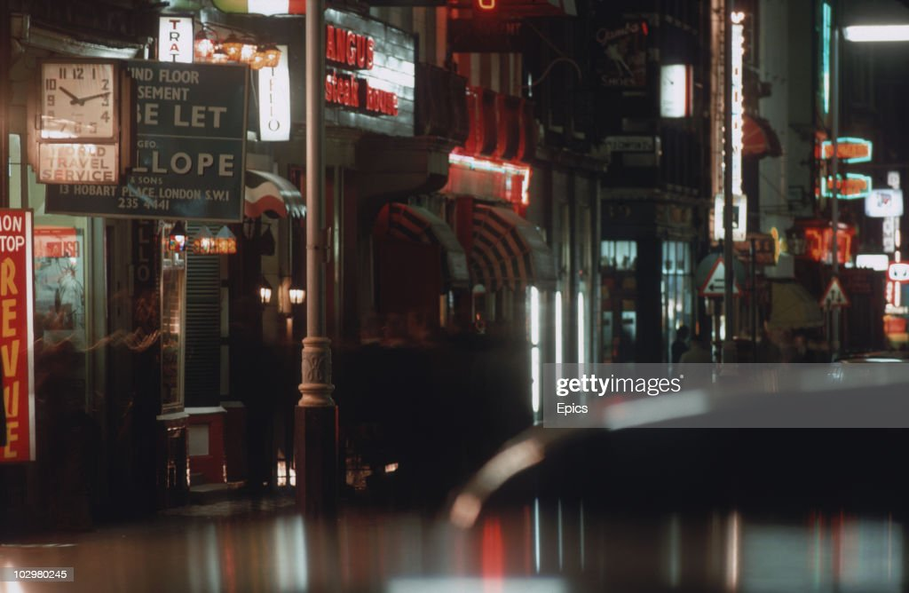 A general view of neon signs lighting up street at night in Soho, London, October 1979.