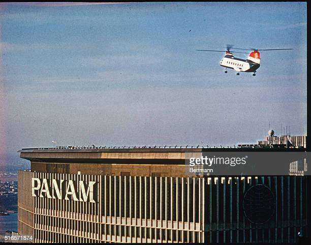 General view of New York Airways helicopter coming in for a landing at the helicopter coming in for a landing at the heloport atop the pan American...