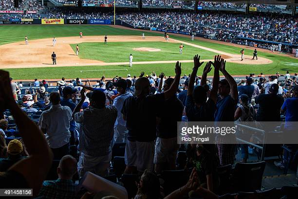A general view of New York Yankees fans cheering during the game between the New York Yankees and the Houston Astros at Yankee Stadium on August 26...