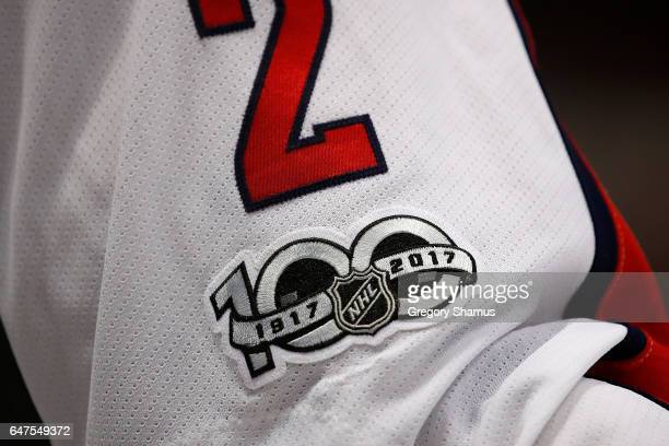 General view of NHL 100 years patch on the jersey of Matt Niskanen of the Washington Capitals while playing the Detroit Red Wings at Joe Louis Arena...