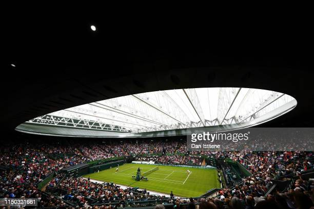 A general view of No 1 Court with the new roof closed as Kim Clijsters of Belgium serves to Venus Williams of the United States during the Wimbledon...