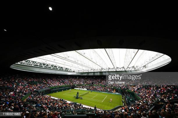 A general view of No 1 Court with the new roof closed as Kim Clijsters of Belgium returns a shot to Venus Williams of the United States during the...