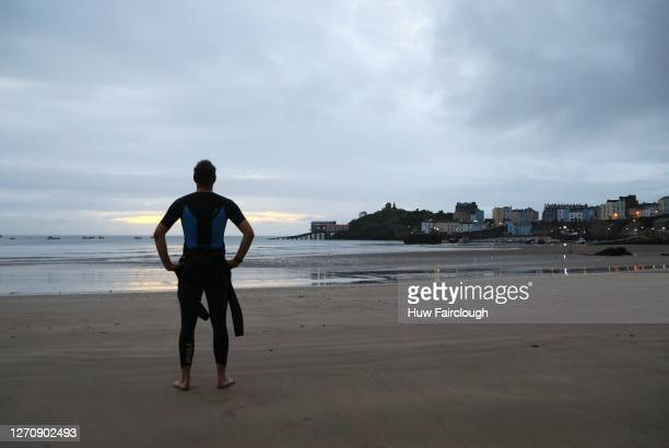 General view of North Beach Tenby, despite the race being cancelled due to Coronavirus Precautions an athlete in his wetsuit visited at the original...