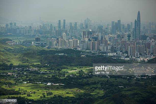 General view of North East New Territories in front of the Shenzhen skyline taken from Ping Che village on July 11, 2013 in Hong Kong, China. The...