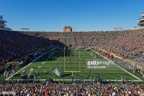 A general view of Notre Dame Stadium as Notre Dame Fighting Irish players coaching staff and cheerleaders run onto the field prior to the start of...