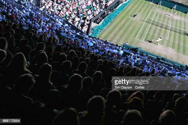 A general view of Novak Djokovic of Serbia in action against Ernests Glubis of Latvia on Centre Court in the Gentlemen's Singles Competition during...