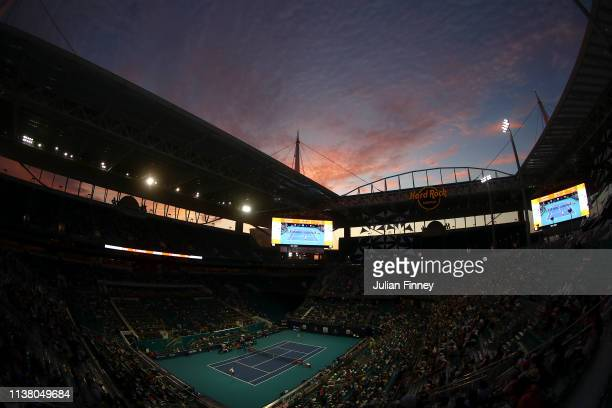 A general view of Novak Djokovic of Serbia serving to Federico Delbonis of Argentina during day seven at the Miami Open Tennis on March 24 2019 in...