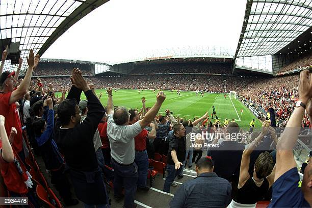A general view of Old Trafford home of Manchester United and fans celebrating Andy Cole's second goal during the FA Carling Premiership match between...