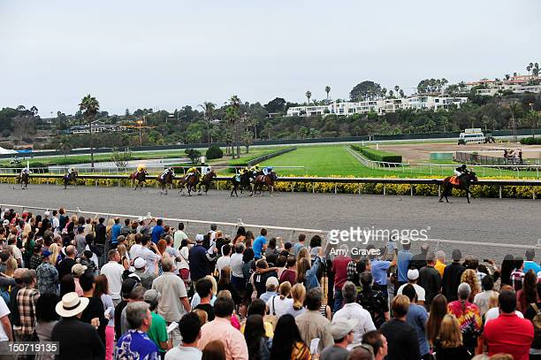A general view of 'Only Josie Knows' racing toward the finish line as TV Personality Josie Goldberg's looks on at Del Mar Race Track on August 24...