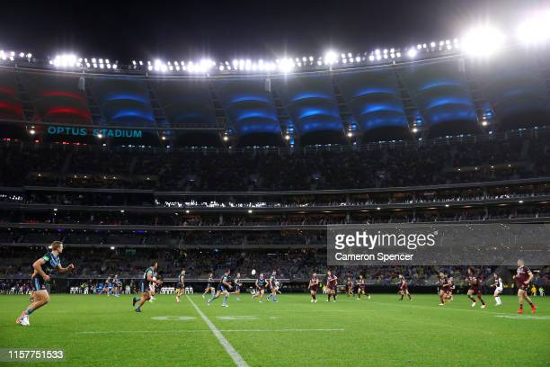 A general view of Optus Stadium as Damien Cook of the Blues passes during game two of the 2019 State of Origin series between the New South Wales...