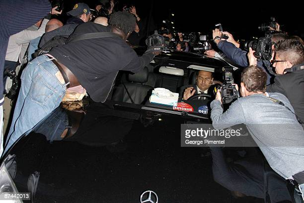 A general view of paparazzi swarming actress/singer Mariah Carey's car as she is seen leaving the Roberto Cavalli dinner held at Roberto Cavalli's...