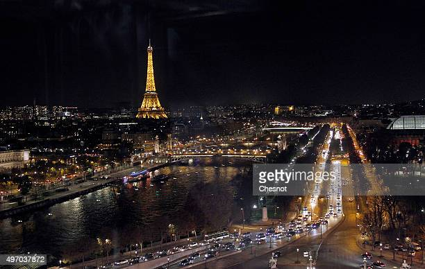 A general view of Paris by night with the Eiffel Tower on November 13 2015 in Paris France Paris will host the World Climate Change Conference 2015...