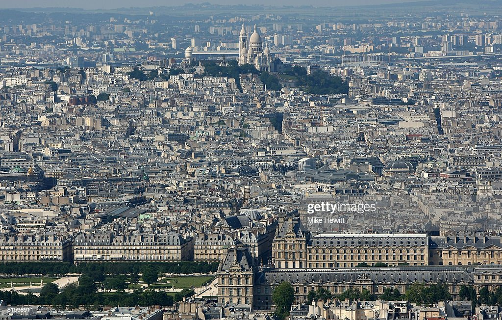 General view of Paris with the Louvre prominent in the foreground and the Sacre Coeur in Monmatre behind on June 10, 2008 in Paris, France.