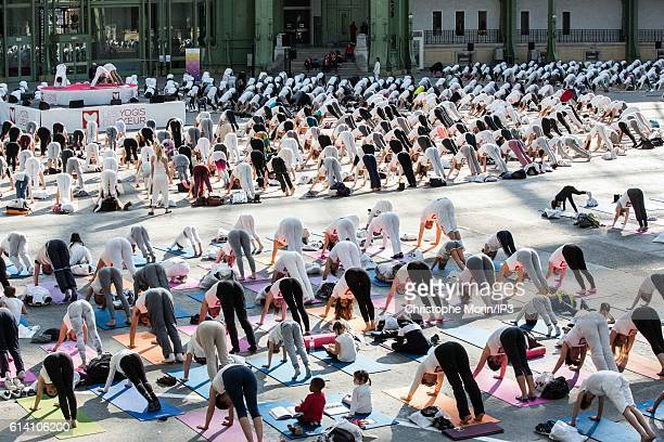 General view of participants at a large yoga gathering hosted by a group of volunteer teachers in support of 'Mecenat Chirurgie cardiaque' a cardiac...