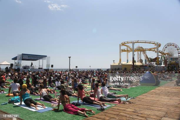 A general view of participants during Health Magazine presents Wanderlust Yoga in the city at Santa Monica Pier on September 9 2012 in Santa Monica...