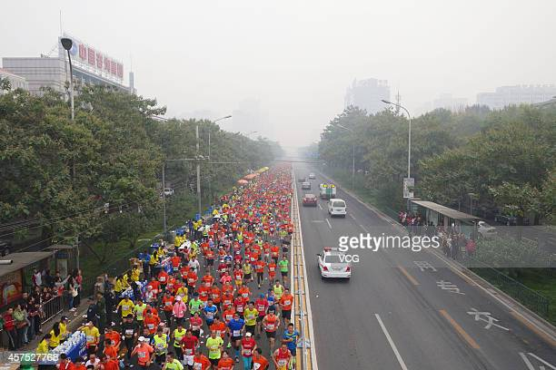 A general view of participants running in the 2014 Beijing International Marathon in the captical of China on October 19 2014 2014 Beijing...