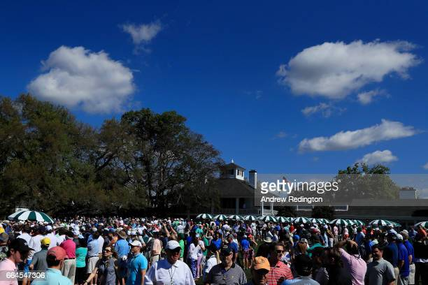 A general view of patrons and the clubhouse is seen near the first hole during a practice round prior to the start of the 2017 Masters Tournament at...