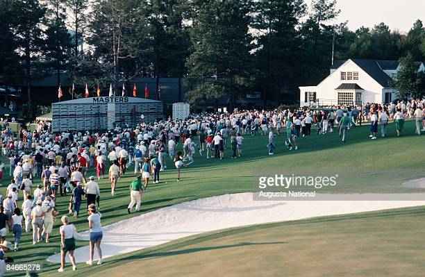 A general view of patrons walking by the main leader board toward the exit during the 1994 Masters Tournament at Augusta National Golf Club on April...