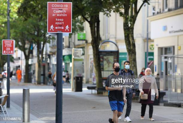 A general view of pedestrians walking through the city centre in view of the social distancing signs on on September 14 2020 in Newport United Kingdom