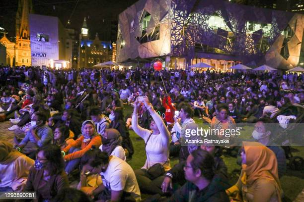 General view of people celebrating New Years at Federation Square are seen minutes before New Year during New Year's Eve celebrations on December 31,...