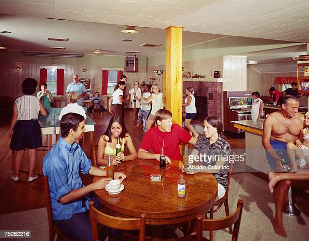 General view of people engaged in a variety of 'entertaining' activities in the social room of the Pine Lake Manor hotel Greenville New York mid to...