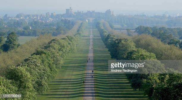 General view of people exercising on The Long Walk with Windsor Castle in the background on April 24, 2020 in Windsor, England. The British...