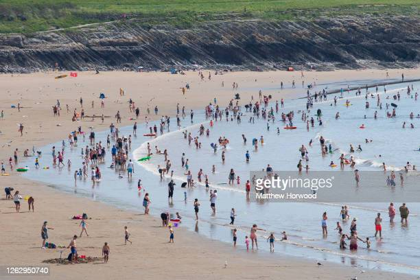 General view of people gathered on the beach and sea at Whitmore Bay, Barry Island, on July 31, 2020 in Barry, United Kingdom. High temperatures are...