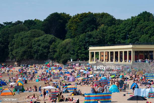 General view of people gathered on the beach at Whitmore Bay, Barry Island, on July 31, 2020 in Barry, United Kingdom. High temperatures are forecast...