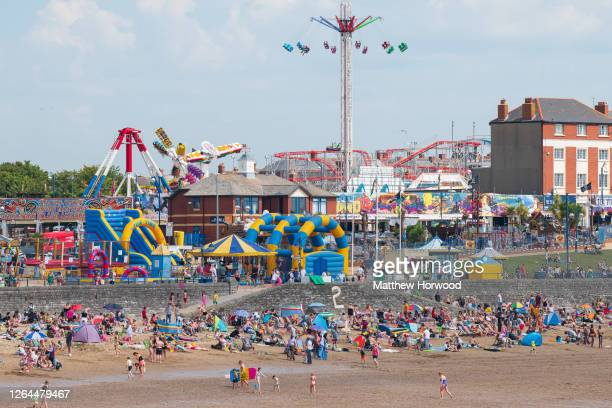 General view of people on the beach at Whitmore Bay, Barry Island on August 7 in Barry, Wales. Forecasters have said Friday could be the hottest day...