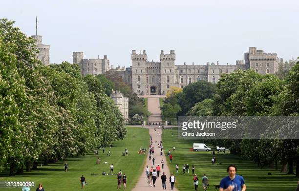 General view of people on The Long Walk and Windsor Castle, with Queen Elizabeth II in residence, on May 08, 2020 in Windsor, United Kingdom.The UK...