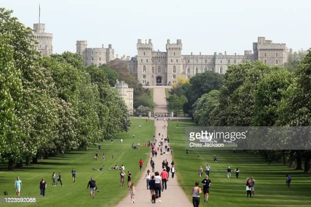 A general view of people on The Long Walk and Windsor Castle with Queen Elizabeth II in residence on May 08 2020 in Windsor United KingdomThe UK...