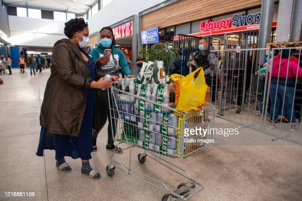 General view of people queuing and buying alcohol at Delft Mall on Day 66 of the National Lockdown on June 01, 2020 in Cape Town, South Africa. It is...
