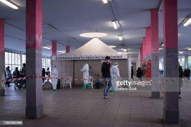 General view of people queuing for swab test for Covid-19 in Via Negarville on October 16, 2020 in Turin, Italy. A new hotspot for swab tests for the...