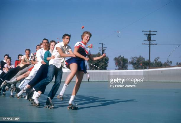 General view of people roller skating in a conga line circa November 1954 at the Westchester SkateLand in Westchester New York