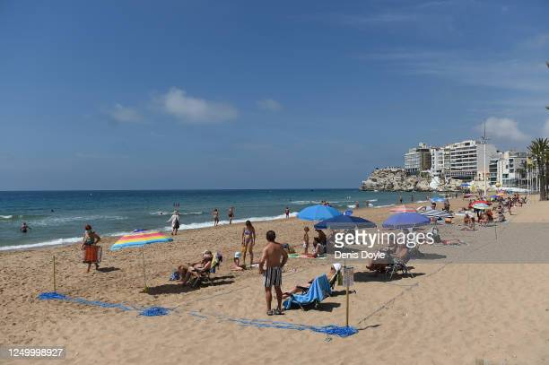 A general view of people taking the sun in their designated areas on Levante beach a day after the town's beaches were reopened after three months of...