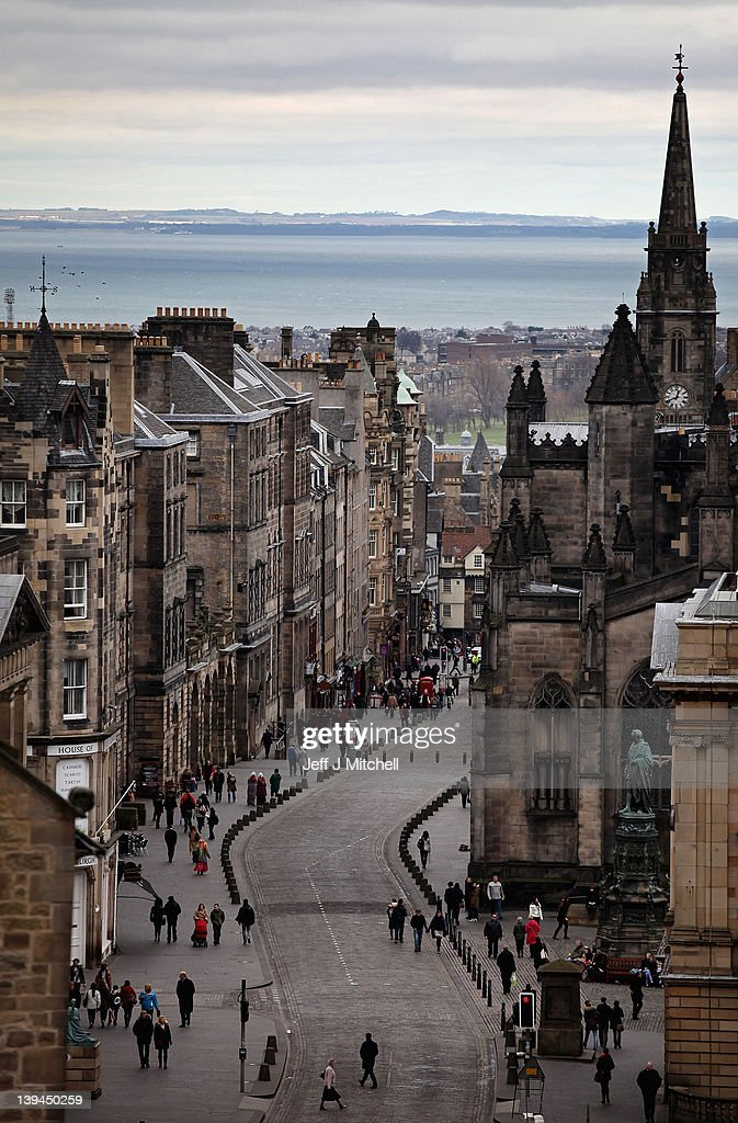 A general view of people walking along the Royal Mile on February 21, 2012 in Edinburgh, Scotland. A favourite with visitors and one of the busiest streets in the city, the Royal Mile runs from Edinburgh Castle at the top down to Holyrood Palace at the foot.